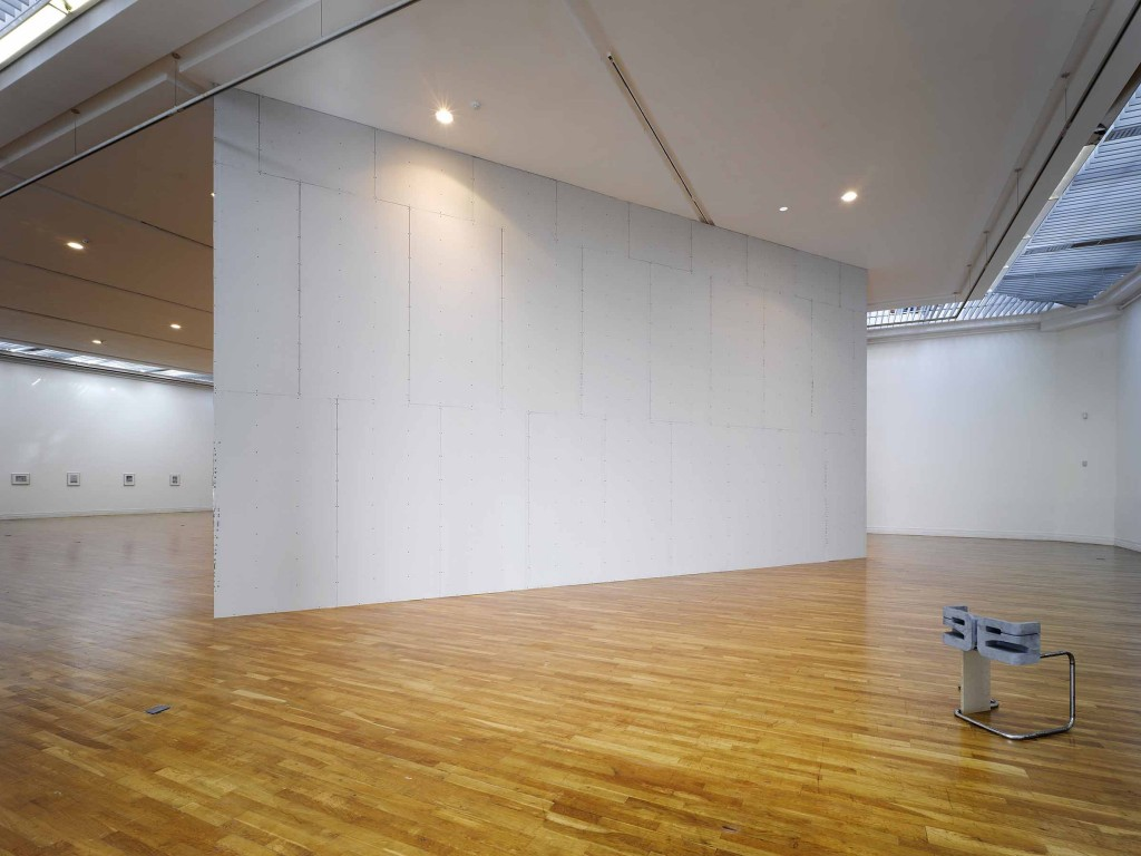 Brendan Earley: Wall (2012), silver backed plaster board and alumnium, 9x5m.