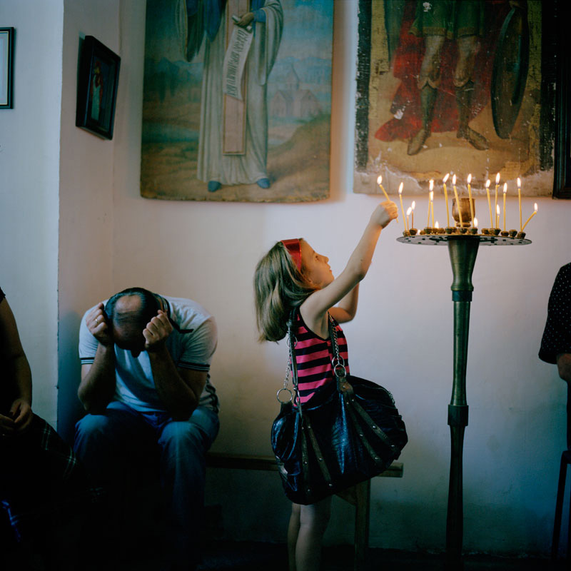 Ivor Prickett - A Young Mingrelian Girl Lights a Candle, digital c type print; image courtesy of the artist.